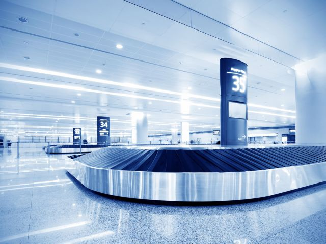 14146988 - single suitcase alone on airport carousel